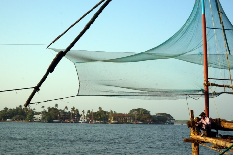 One of the fishermen working the Chinese fishing nets